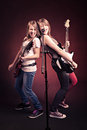 Rock and roll girls portrait of two young with a guitar on the stage Stock Images