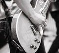 Rock and roll play on guitar selective focus on part of hand strings Royalty Free Stock Photo