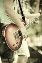 Rock and roll play on guitar selective focus on part of strings Royalty Free Stock Photos