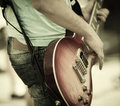 Rock and roll play on guitar selective focus on part of strings Stock Image