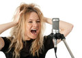 Rock singer screaming to the microphone Royalty Free Stock Photo