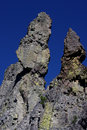 Rock spires against blue sky two colorful dark in crater lake national park Royalty Free Stock Photography