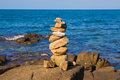 Rock stack over seacoast skyline background Royalty Free Stock Photo