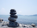 Rock stacked, stones stack on the coast of the Sea in the nature. Life balance, spa stones treatment scene concept. Stones on Hin Royalty Free Stock Photo