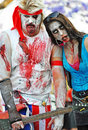 Rock star & crazy fan woman groupie zombies in famous annual Zombie Walk event Brisbane City, Australia Royalty Free Stock Photo