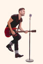 Rock star singing with guitar Royalty Free Stock Photo