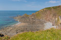 Rock strata beach in rocky beach cove hartland point peninsula near clovelly devon england Royalty Free Stock Photos