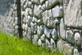 Rock wall against green grass Stock Photo