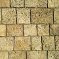 Rock wall background with grid of bricks Royalty Free Stock Images