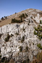 Rock wall a in the hills near vipava valley in slovenia on a sunny winter day Royalty Free Stock Photography
