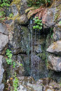 Rock Wall And Water Royalty Free Stock Photo