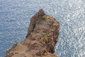 The rock which has hung over ocean portugal island madeira of july a Stock Images