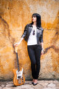 Rock woman young in style clothes with electric guitar outdoor shot Stock Image