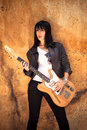 Rock woman young in style clothes with electric guitar outdoor shot Royalty Free Stock Photos