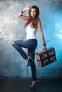 Rock young woman with suitcase with british flag portrait of casual metal wall as a background Royalty Free Stock Photography