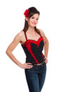 Rockabilly girl with bustier top and jeans a beautiful wearing a black red a red flower hair accessory shot in the studio Stock Images