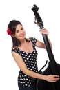 Rockabilly girl playing a double bass beautiful smiling and black shot in the studio and isolated on white background Royalty Free Stock Photo
