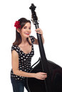 Rockabilly girl playing a stand up bass beautiful smiling and black shot in the studio and isolated on white background Royalty Free Stock Photos