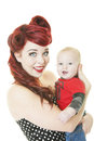 Rockabilly mom baby a young mother dressed in style holding her month old teething son shot on white background Royalty Free Stock Image
