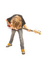 Rocker boy playing bass guitar isolated on white background Stock Photography