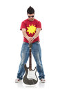 Rocker holds guitar between legs Stock Image