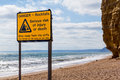 Rockfalls warning sign at burton bradstock droset england uk Stock Photography