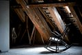 Rocking chair in the empty attic Stock Images