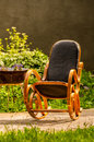 Rocking chair in the garden Royalty Free Stock Photo