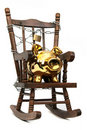 Rocking chair and piggy bank captured with chain a Royalty Free Stock Photography