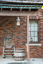 Rocking chair a on a porch of an old brick house Royalty Free Stock Images