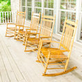 Rocking chairs invite one to relax on an old wooden front porch Royalty Free Stock Photos