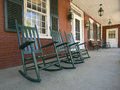 Rocking chairs on porch of historic new england house in vermont Stock Photography