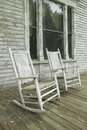 Rocking chairs on porch of southern house in disrepair along Highway 22 in Central Georgia Royalty Free Stock Photo