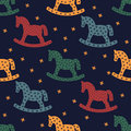 Rocking horse silhouette. Seamless pattern with rocking horses on dark blue background. Royalty Free Stock Photo