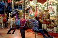 Rocking horses in the Merry go round, Jubilee Gardens South Bank London England -