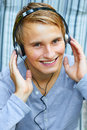 Rocking with some beats young male listening to music via headphones Stock Image