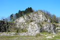 Rocks in abandoned quarry former limestone kamenarka near stramberk czech republic with old stone walls under it Royalty Free Stock Image