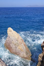 Rocks in blue sea closeup of waves breaking on on coastline of cyclades islands greece Royalty Free Stock Image