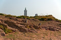Rocks with lighthouse at the cape of frehel brittany france Stock Images