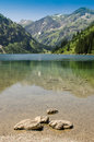 Rocks in a mountain lake the vilsalpsee tirol austria Stock Photography