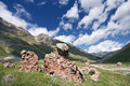 Rocks in mountain valley with grass, Caucasus Stock Photos