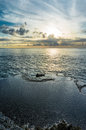 Rocks near the sea. Sunset sky reflected in the pools Royalty Free Stock Photo