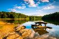 Rocks and a picnic table in Lake Marburg, at Codorus State Park, Pennsylvania. Royalty Free Stock Photo