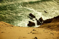 Rocks and sand along coast Royalty Free Stock Photo