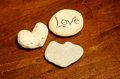 Rocks shaped like hearts with word love for peaceful scene Stock Photo