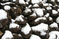 Rocks with snow pile of and ice Stock Images