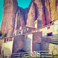 Rocks spanish medieval church at the foot of the in the pyrenees retro effect Stock Images