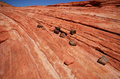 Rocks on striped sandstone near the fire wave in valley of state park in nevada Royalty Free Stock Photography