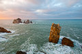Rocks in te ocean water at sunset. Cantabria Stock Photo