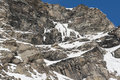Rocky alpine mountainside in winter rugged covered snow and ice Royalty Free Stock Photography